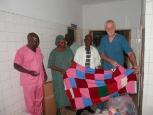 Dr. Kees presents new blankets at Laure Fistula Center