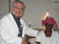 Angola_Dr.Steven.Foster.w.patient_CEML