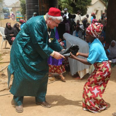 Dr. Steve Arrowsmith celebrates with fistula patients at the joyous ceremony. Photography by Sam Olukoya