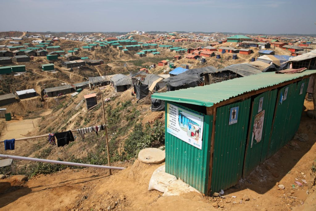 A sprawling Rohingya refugee camp in Bangladesh, stretching farther than the eye can see. Photography by Touhital Islam